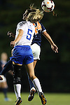 26 September 2013: Duke's Kaitlyn Kerr (5) and Virginia's Danielle Colaprico (24) challenge for a header. The Duke University Blue Devils hosted the University of Virginia Cavaliers at Koskinen Stadium in Durham, NC in a 2013 NCAA Division I Women's Soccer match. Virginia won the game 3-2.