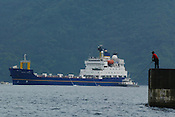 FISHERMAN IN UCHIURA BAY, BESIDE THE TAKAHAMA NUCEAR PLANT, AS BNFL SHIP 'PACIFIC PINTAIL' ARRIVES EARLY MORNING FOR RETRIEVAL OF REJECTED PLUTONIUM MOX FUEL, FOR SHIPMENT BACK TO THE UNITED KINGDOM. TAKAHAMA, JAPAN. 04/07/02. .PIC &copy; JEREMY SUTTON-HIBBERT/GREENPEACE 2002..*****ALL RIGHTS RESERVED. RIGHTS FOR ONWARD TRANSMISSION OF ANY IMAGE OR FILE IS NOT GRANTED OR IMPLIED. CHANGING COPYRIGHT INFORMATION IS ILLEGAL AS SPECIFIED IN THE COPYRIGHT, DESIGN AND PATENTS ACT 1988. THE ARTIST HAS ASSERTED HIS MORAL RIGHTS. *******