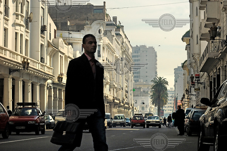 A man crosses Boulevard Mohammed V in Casablanca's French colonial era New Town.