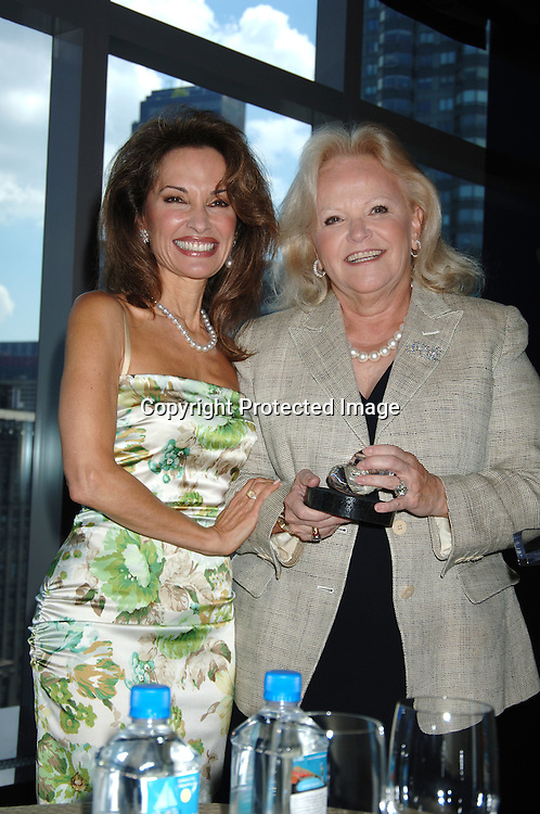 Honorees Susan Lucci and Jane Pontarelli ..at The Rose Luncheon honoring Susan Lucci and Jane ..Pontarelli on June 13, 2006 at the Mandarin Oriental Hotel. ..The Rose Luncheon is benefitting Little Flower Children and ..Family Services of New York. ..Robin Platzer, Twin Images