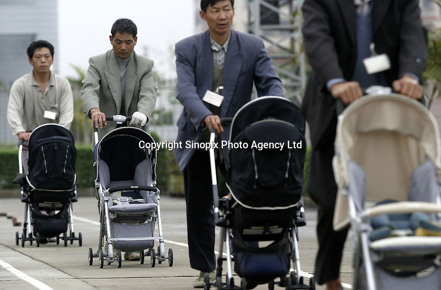 Workers test the products at the Japanes-owned Combi Strollers factory in Tangxia, Dongguan City, Guangdong Province, China. Each stroller is pushed by two alternating workers who together walk some 40 kilometers a day for a week to test selected strollers..27-MAR-04