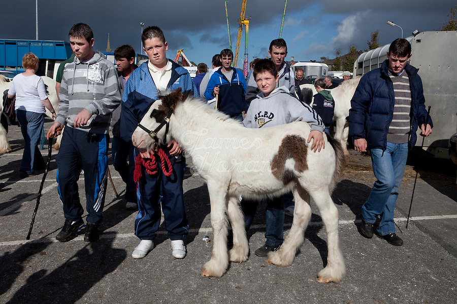 3/10/2010.  Traveller boys Bim Cleary 11 and his brother Bim 13 from Galway pose with their pony at the Ballinasloe Horse Fair, Ballinasloe, County Galway, Ireland. Picture James Horan
