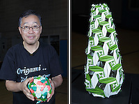 New York, NY, USA - June 24, 2011: Toshikazu Kawasaki, Origami designer from Japan at the OrigamiUSA Convention in New York City with two of his creations