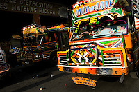 A tap-tap bus departs for its regular route in the downtown of Port-au-Prince, Haiti, 26 July 2008. Tap-tap vehicles serve as public transportation in Haiti. They are private, operate over fixed routes, departing only when full. Tap-taps are decorated with bright and shiny colors and with a lot of fancy designed elements. There are scenes from the Bible, Christian slogans, TV stars or famous football players often painted on a tap-tap body. Tap-tap name comes from sound of taps on the metal bus body signifying a passenger's request to be dropped off.