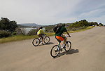 Bikers at Angel Island State Park, in San Francisco Bay, CA, California.  People disembark and picnic at Ayala Cove, then hike, bike, or tram perimeter road, with stops at Civil War era Camp Reynolds, and its restored officer house, or Spanish American War era Fort McDowell..Photo camari256-70522..Photo copyright Lee Foster, www.fostertravel.com, 510-549-2202, lee@fostertravel.com.