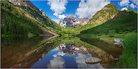 After an early morning of landscape photography at Crater Lake under the shadow of the iconic Maroon Bells, I made my way back down Maroon Creek, eventually ending up where everone takes their pictures of the lake and both Maroon and North Maroon Peaks in the distance. And I had to take part, too, especially because skies were just about perfect for a summer morning, and the reflections were like glass.<br />