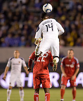 LA Galaxy forward Edson Buddle (14) leaps high to head a ball over Toronto FC's Amadou Sanyang (22). The LA Galaxy and Toronto FC played to a 0-0 draw at Home Depot Center stadium in Carson, California on Saturday May 15, 2010.  .