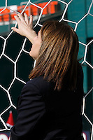 Referee Sandra Serafini inspects the goal netting before the match. The women's national team of the United States defeated Canada 6-0 during an international friendly at Robert F. Kennedy Memorial Stadium in Washington, D. C., on May 10, 2008.