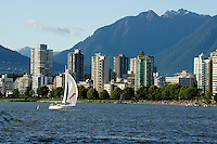 Sailboat with North Shore mountains and West End skyline, Vancouver, British Columbia, Canada