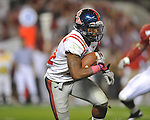Ole Miss running back Brandon Bolden (34) runs at Bryant-Denny Stadium in Tuscaloosa, Ala.  on Saturday, October 16, 2010. Alabama won 23-10.