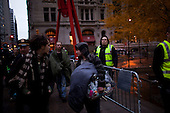 New York, New York<br /> November 15, 2011<br /> <br /> After the police clear Zuccotti Park many of the evicted &quot;Occupy Wall Street&quot; protesters, reconvened in Foley Square but some of them stayed around the park with their belongings not knowing where to go.
