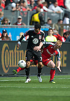 05 May 2012: D.C. United midfielder Dwayne De Rosario #7 and Toronto FC defender Richard Eckersley #27 in action during an MLS game between DC United and Toronto FC at BMO Field in Toronto..D.C. United won 2-0.