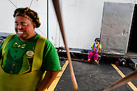 A dwarf clown takes a rest, together with his clown collegue, in the backstage of Circus Renato, in San Salvador, El Salvador, 7 May 2011.