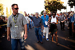 "Filmmaker George Lucas, accompanied by his fiance Mellody Hobson, right, waves to spectators before the American Graffiti Parade in Modesto, California, June 7, 2013. Modesto is celebrating the 40th anniversary of the film ""American Graffiti"", with a parade headed up by native son, filmmaker George Lucas."