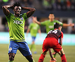 Seattle Sounders Obafemi Martins (9) reacts acter tripping Portland Timbers Liam Ridgewell (24) ball for ball control during an MLS match on April 26, 2015 at CenturyLink Field in Seattle, Washington.  Seattle Sounders Clint Dempsey scored a goal to give the Sounders a 1-0 victory over the Timbers. Jim Bryant Photo. ©2015. All Rights Reserved.