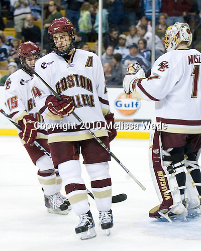 Joe Whitney (BC - 15), Matt Lombardi (BC - 24), John Muse (BC - 1) - The Boston College Eagles defeated the University of Maine Black Bears 7-6 in overtime to win the Hockey East championship on Saturday, March 20, 2010, at TD Garden in Boston, Massachusetts.