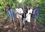 Members of the Arrow Boys, a self-defense militia, in the village of Riimenze, in Southern Sudan's Western Equatoria State. The men patrol the forest around the village, especially at night, on the look out for the Lord's Resistance Army, which has displaced tens of thousands in recent months along the border area. Many believe the northern Sudan government is behind the attacks in its desire to destabilize the south in the period leading to a January 2011 referendum on secession.