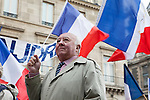 Portrait of a French man on May Day, or Labor Day, March in Paris, France, Europe