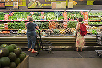 Shoppers browse produce at the Whole Foods Market in the East Village in New York on Saturday, May 30, 2015. (© Richard B. Levine)