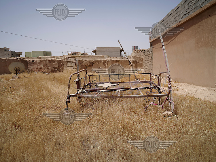 Old bed frames in Dogre village in the Sinjar mountains which was home to Adol, 43, a Yazidi woman, until she fled th eadvance of ISIS in August 2014.