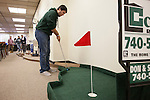 Kirby Flowers putts a golf ball toward the first hole during the Alden Open, a Dad's Weekend Mini-Golf event in Alden Library, on Saturday, November 7, 2015. Photo by Kaitlin Owens