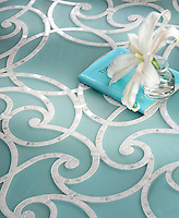 Abigail, a handmade mosaic shown in honed Aquaberyl glass and polished Calacatta. Designed by Sara Baldwin Designs for New Ravenna.<br />
