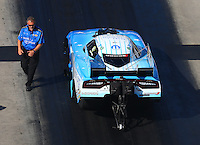 Jun 17, 2016; Bristol, TN, USA; Crew chief Kurt Elliott with NHRA funny car driver Tommy Johnson Jr during qualifying for the Thunder Valley Nationals at Bristol Dragway. Mandatory Credit: Mark J. Rebilas-USA TODAY Sports