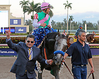 HALLANDALE BEACH, FL - JANUARY 28:  #1 Arrogate with jockey Mike Smith heads to the winners' circle after winning the Pegasus World Cup Invitational G1with Arrogate at Gulfstream Park on January 28, 2017 in Hallandale Beach, Florida. (Photo by Liz Lamont/Eclipse Sportswire/Getty Images)