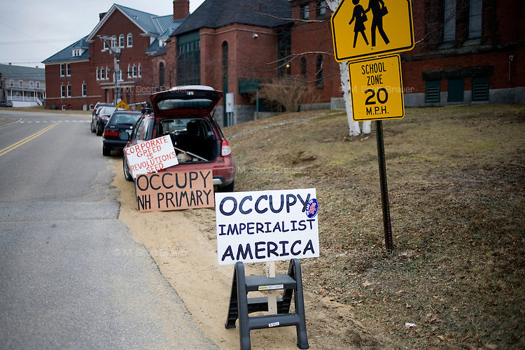 Members of Occupy New Hampshire stand outside a Rick Santorum town hall in Northfield, New Hampshire. Santorum is seeking the 2012 GOP nomination for president.