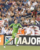 Seattle Sounders FC defender Marc Burch (8) tracks high ball. In a Major League Soccer (MLS) match, the New England Revolution tied the Seattle Sounders FC, 2-2, at Gillette Stadium on June 30, 2012.