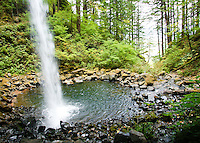 Ponytail Falls in Columbia River Gorge, OR during the Fall.  You can walk behind this waterfall and is very scenic hike.