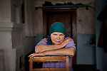 _2SM1012; Karelia, Russia, 6/2012; RUSSIA-10045. A woman sits on a chair. <br />