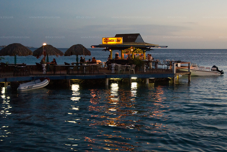 Kralenkijk, Bonaire, Netherland Antilles -- The over-water cappuccino bar at Karel's Pier is a popular place to rest, right at the center of the waterfront in Kralendijk.