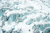 Massive crevasses and seracs of blue ice in upper parts of Fox Glacier, Westland Tai Poutini National Park, West Coast, UNESCO World Heritage Area, New Zealand, NZ