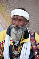 Hindu man pilgrim with beads and turban at Dashashwamedh Ghat in holy city of Varanasi, Benares, India