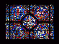 fragment of the Zodiac Signs Window depicting a hooded peasant pruning his wine (lower left), Aries among trees (lower right), May (helmeted soldier with horse grazing) and Gemini (naked Twins holding hands) in the quatrefoil, April as a woman standing between flowering trees (upper left), and Taurus, the bull standing among trees, 13th century, ambulatory, Chartres Cathedral, Eure et Loir, France Picture by Manuel Cohen