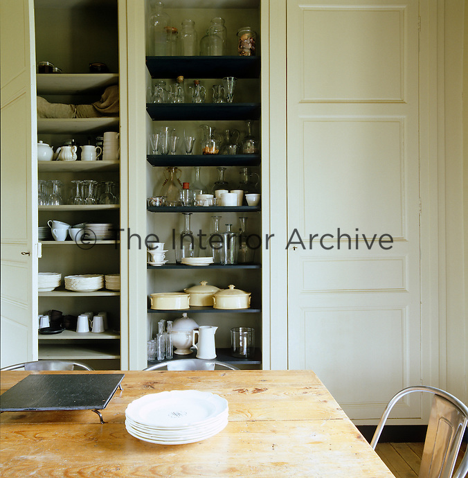 In Normandy late 18th century doors were restored to provide storage for antique glass and 19th century creamware