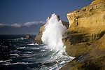 Cape Kiwanda State Park National Recreation Area big waves breaking onto rocky cliffs afternoon with blue skies Northern Oregon Coast near Pacific City Oregon State USA.