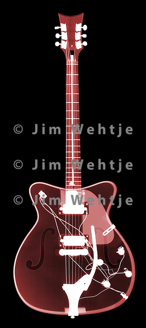 X-ray image of an electric guitar (red on black) by Jim Wehtje, specialist in x-ray art and design images.