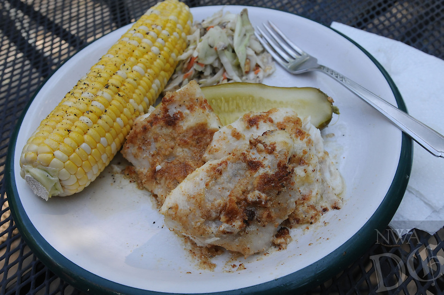 NWA Democrat-Gazette/FLIP PUTTHOFF <br /> Oven baked fish is an easy, delicous and    July 13, 2016   healthy way to enjoy the catch of the day. There's no oil, batter or breading to deal with and cleanup is a breeze.