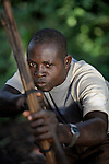 Simon Peter Gamana patrols the forest near his village of Riimenze, in Southern Sudan's Western Equatoria State, on the look out for the Lord's Resistance Army, which has displaced tens of thousands in recent months along the border area. Many believe the northern Sudan government is behind the attacks in its desire to destabilize the south in the period leading to a January 2011 referendum on secession.