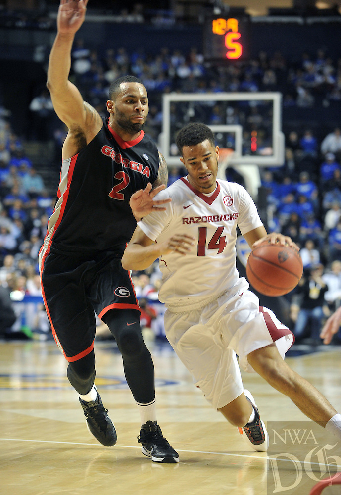 NWA Democrat-Gazette/Michael Woods --03/14/2015--w@NWAMICHAELW... University of Arkansas guard Nick Babb drives to the hoop past Georgia defender Marcus Thornton during the first half of the Razorbacks 60-49 win in Saturdays game against the Georgia Bulldogs at the 2015 SEC basketball tournament at Bridgestone Arena in Nashville.