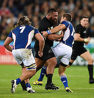 Charlie Faumuina of New Zealand is tackled by JC Greyling of Namibia. Rugby World Cup Pool C match between New Zealand and Namibia on September 24, 2015 at The Stadium, Queen Elizabeth Olympic Park in London, England. Photo by: Patrick Khachfe / Onside Images