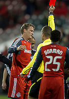 16 April 2011: Toronto FC defender Ty Harden #20 receives a red card from referee Mark Kadlecik during an MLS game between D.C. United and the Toronto FC at BMO Field in Toronto, Ontario Canada..D.C. United won 3-0.