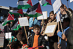 "Palestinian children hold flags and paper ships reading in Arabic ""No to the siege"" during a rally to protest against the Israeli siege of the Gaza Strip on November 30, 2013 at Gaza City harbour. Photo by Ashraf Amra"