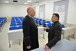Cardinal Timothy Dolan (left), archbishop of New York and chair of the Catholic Near East Welfare Association, talks with Chaldean Archbishop Bashar Matti Warda in the Catholic University in Ankawa, near Erbil, Iraq, on April 11, 2016.
