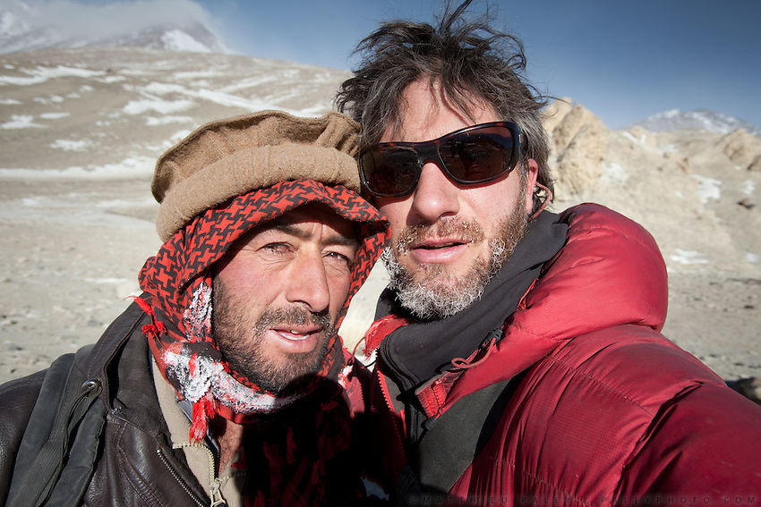 Malang (Afghanistan's number one climber) and Matthieu Paley, photographer..Going back down to Sarhad village with a yak caravan led by 2 Wakhi traders: Shur Ali and Roz Ali...Trekking down the Wakhan frozen river, the only way down to leave the high altitude Little Pamir plateau, home of the Afghan Kyrgyz community.