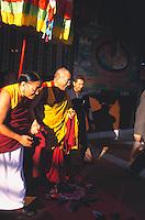 His Holiness the Dalai Lama being led by Sakya Trizin at Muduwala Tibetan settlement.