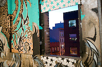 15 December 2006 - New York City, NY - View out of an open window surrounded by artwork on display in a three-day street art exhibition held in a 19th-century brick building at 11 Spring Street in the NoLIta neighborhood of New York City, USA, 15 December 2006. The building's new owners, Caroline Cummings and Bill Elias, called on the Wooster Collective to curate the show as a last hurrah for a site that long served as a canvas for street art.<br />