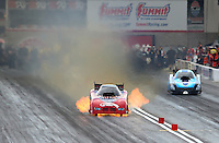 Mar 29, 2014; Las Vegas, NV, USA; NHRA funny car driver Gary Densham has a fire during qualifying for the Summitracing.com Nationals at The Strip at Las Vegas Motor Speedway. Mandatory Credit: Mark J. Rebilas-